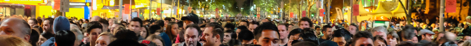 crowd in a street at night for banner for participants page